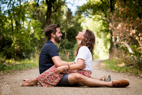 Crossed-legs, hiking trail engagement photography in the South of France