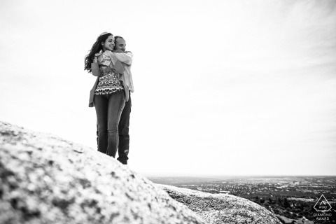 Black and white rocky engagement shoot with a white background on a mountain stone in Torrelodones, Madrid, Spain