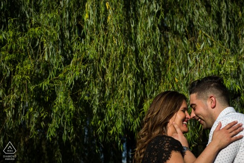 Tender Loving engagement photos at Arnadelo, Ponferrada with green leaves and a romantic couple