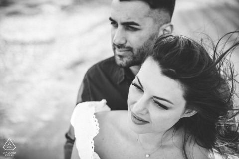Intimate engagement photos at Athens, Greece of couple on the beach wind blown