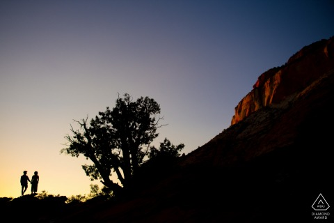 Mountain engagement photography at Zion National Park with a Sunset over the mountains