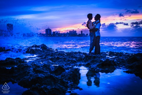 La Havane Engagement shoot at the water with crashing waves and blue tones and hues