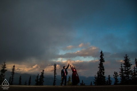 A newly engaged couple dances during sunset at Squaw Pass Colorado