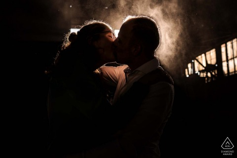 Intimate engagement portrait inside the factory of Old steel factory in Alblasserdam with a lot of dust
