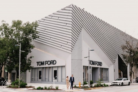 Engagement shoot in Miami Design District, FL standing in front of the Tom Ford building