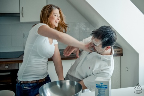 E-session of couple in Picardie, France having fun with a flour battle in the kitchen