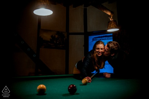 Picardie engagement portrait of couple playing billiards in France