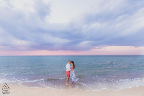 Couple shares a hug during sunset at their engagement session on Nantucket