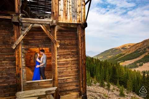A newly engaged couple explore an old mine on the edge of a mountain valley in Keystone, Colorado