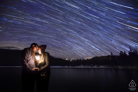 An Echo Lake, Colorado engaged couple brave the cold night air at Echo lake for the star trail engagement photos they'd dreamed of