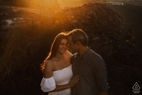 Lavras Novas, Brazil Embraced couple at sunset for their engagement portraits