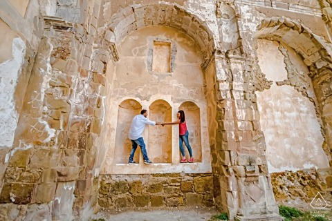 La Iruela, Jaén Pre-Wedding portraits of a couple holding hands at the ruins of the old building