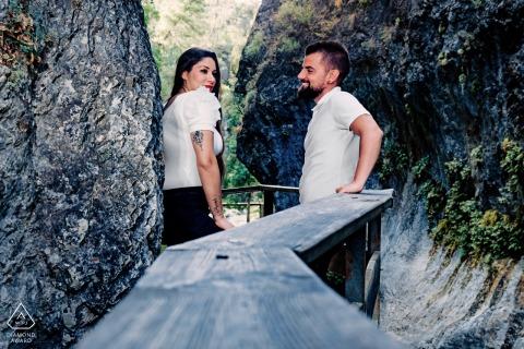 Cerrada de Elías, Jaén Pre-Wedding portrait session with a couple leaning on a wooden rail