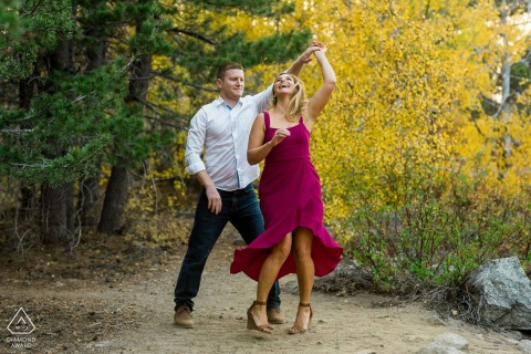 Markleeville, CA couple dances in the trees during their engagement session in the fall colors