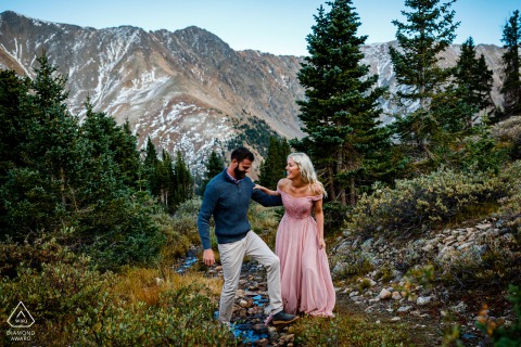 Keystone, CO Mountain Adventure engagement portrait session for a couple in formal-style dress