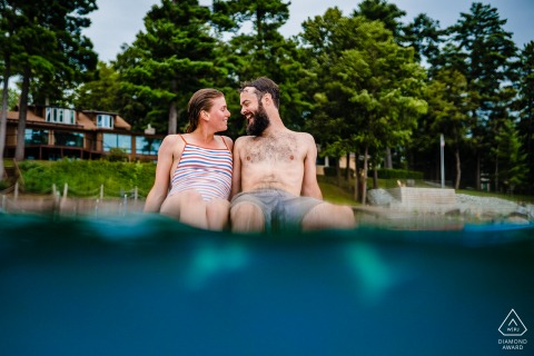 Partially Underwater Engagement session on a paddle board on Lake Champlain in Vermont