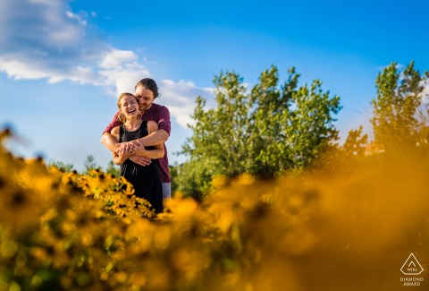 Engagement session along the shore of Lake Champlain, Vermont with warm and cool colors