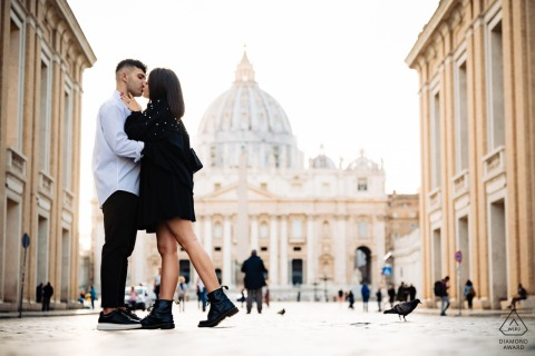 Rome, Italy Couple kissing in front of the Vatican during their pre-wedding engagement photo session