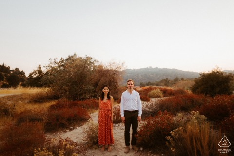Los Angeles, California couple posing for a straight forward engagement photo with some Fall feels