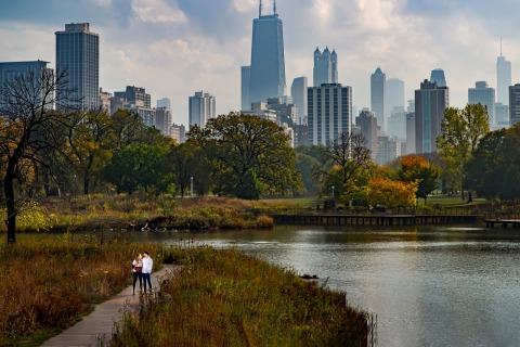 Lincoln Park, Chicago couple engagement portraits with the city skyline and and a big landscape