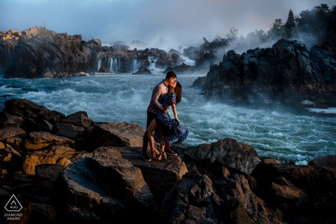 The couple stand on the rocky coast near Great Falls for their Virginia engagement e-session
