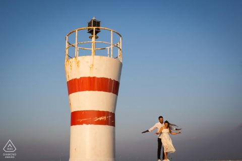 Izmir, Turkey sea light flying couple portrait session by the lighthouse tower