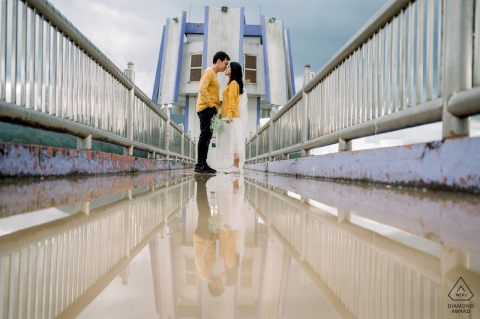 Dalat Pre Wedding portraits on the bridge with water puddle reflections