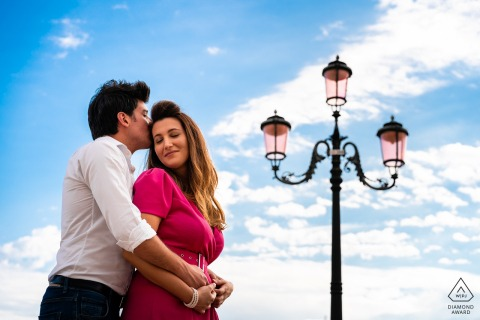 Venice, Italy young engaged couple pose for pre-wed portraits with a view Into the sky