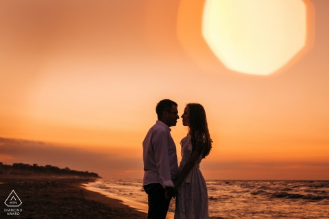 Bursa Sunset pre-wedding photography of a couple looking at each other at the beach
