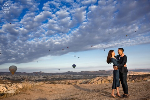 cappadocia, turkey engagement shooting with hot air balloons in the background