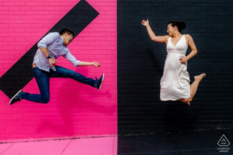 DC Engagement Rock Stars photography with pink and black painted bricks and a jumping couple