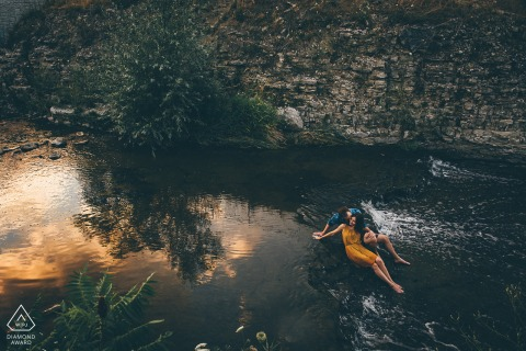 Ontario pre wedding and engagement photography in Hamilton, Ontario with a Couple above the creek at golden hour