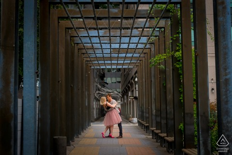 Canada pre-wedding photo session with an engaged couple in Yorkville, Ontario with a a dip on walk way