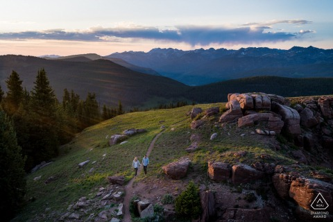 Vail pre wedding portrait session with engaged lovers in Colorado with a Couple hiking in the mountains