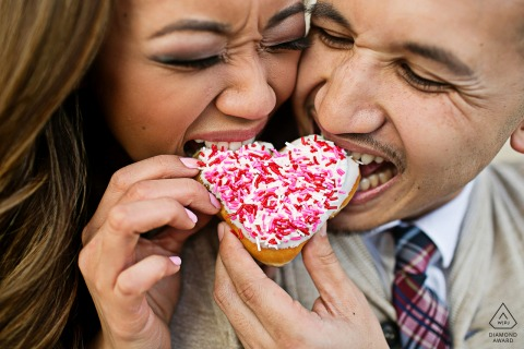 CA engagement portrait with a posed coupleeating at the San Jose City Hall Rotunda with some Sweet Donut Love