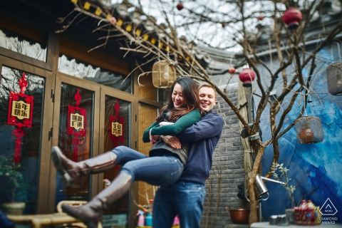 Beijing engagement portrait with a posed couple having a fun afternoon in NanLuoGuXiang Hutong