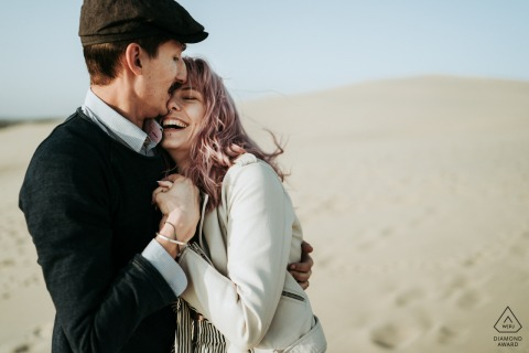 FR pre wedding portrait session with engaged lovers embracing at The dune of Pyla, France