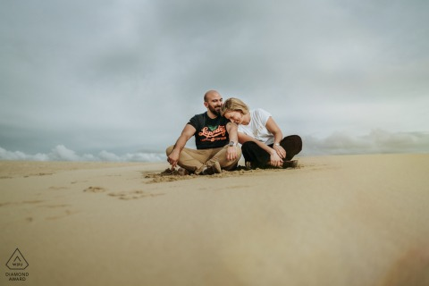 FR engagement photoshoot & pre-wedding session in The dune of Pyla, France with A couple on the sand dunes