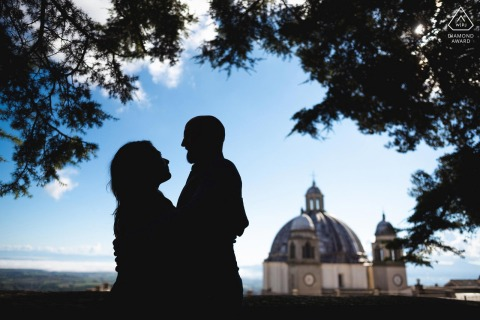 Italy engagement photoshoot & pre-wedding session in Rocca dei Papi, Montefiascone of a silhouette of a couple that looks into each other's eyes