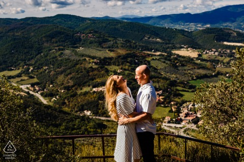 IT pre-wedding photo session with an engaged couple overlooking Spoleto - Italy - He said something really funny