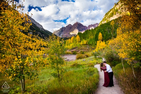 CO engagement photoshoot & pre-wedding session in Keystone, Colorado of the couple practicing their first dance in the gold aspen forest in front of the majestic Maroon Bells