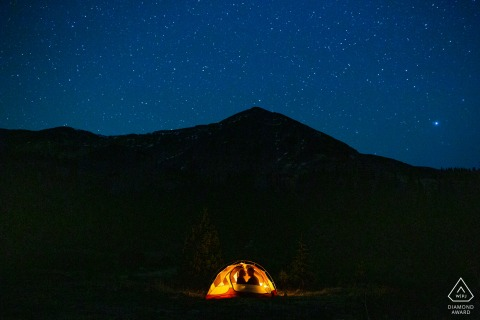 CO pre wedding and engagement photography in Keystone Colorado showing this couple's love of camping in the mountains which inspired this nighttime engagement portrait