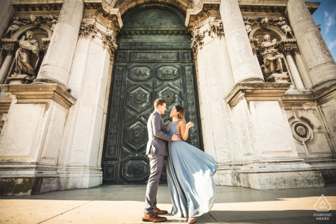IT pre wedding portrait session with engaged lovers before building columns in Venice