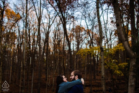 MD engagement photo shoot in Rockville, Maryland of the two lovers in the forest during fall season