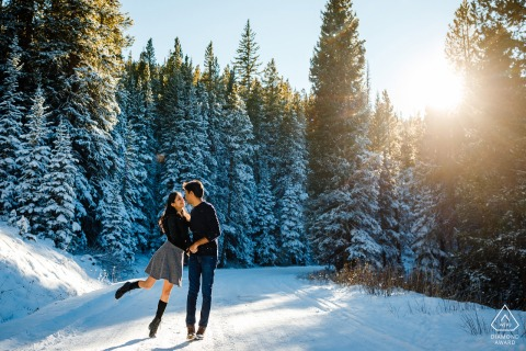 Colorado Winter pre wedding and engagement photography of a couple dancing in the snow in Breckenridge, CO