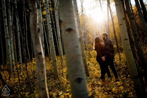 Colorado pre wedding portrait session with engaged lovers in Vail during autumn