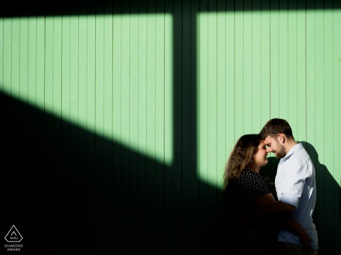 AUS engagement photoshoot & pre-wedding session at Inveresk Launceston, Tasmania, Australia of the couple framed by shadows cast by the hard afternoon sun