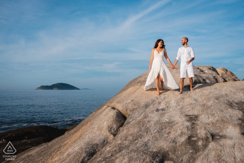 Brazil engagement photo shoot of a couple xxploring all the rocks around the beach in Niteroi, RJ, Brazil