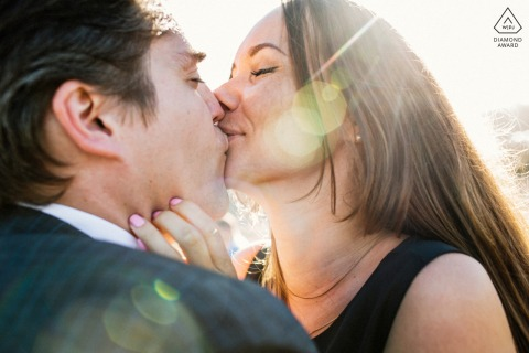 Bay Area engagement photoshoot & pre-wedding session from San Francisco with An affectionate kiss in the sun flare