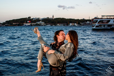 Turkey engagement portrait with a posed couple at the water of karakoy, istanbul